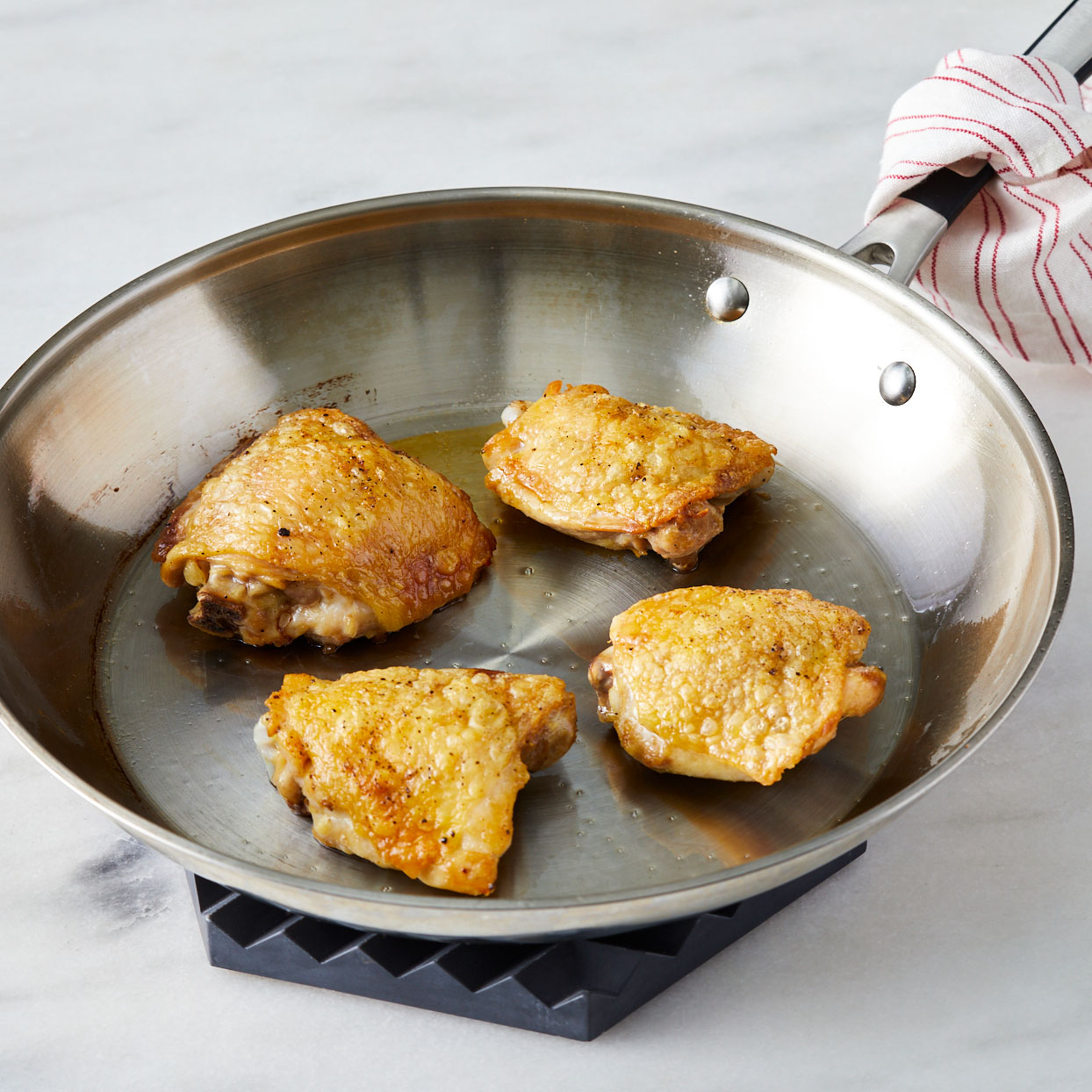 Chicken-thighs-cooking-in-a-skillet