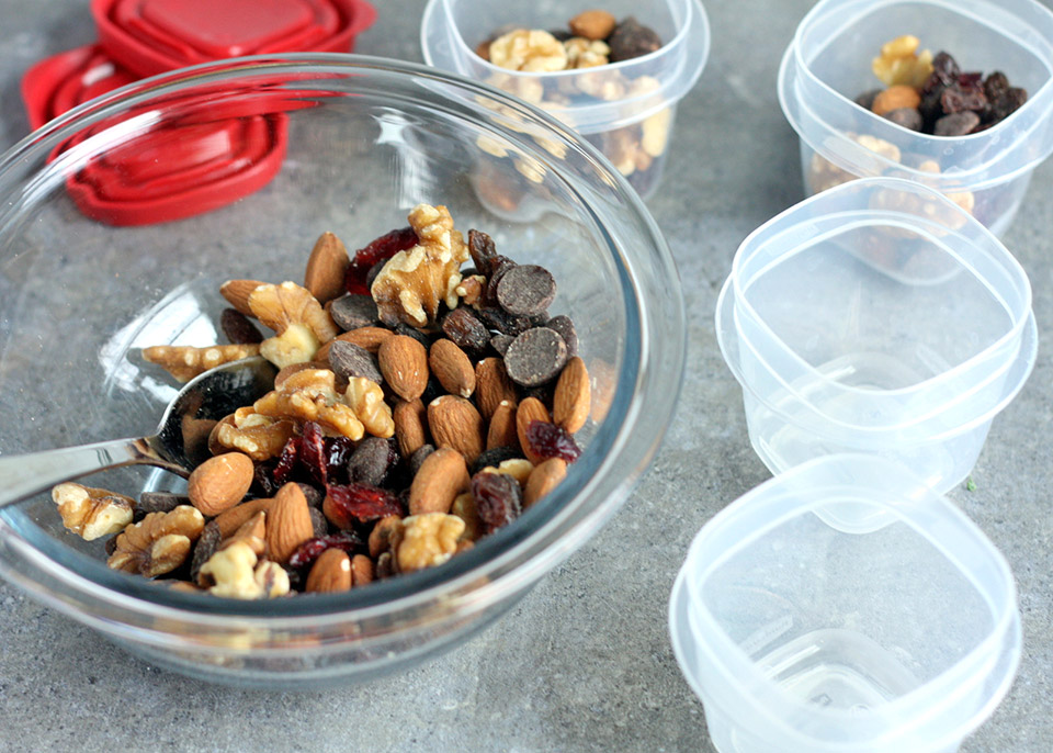 bowl of trail mix with tupperware