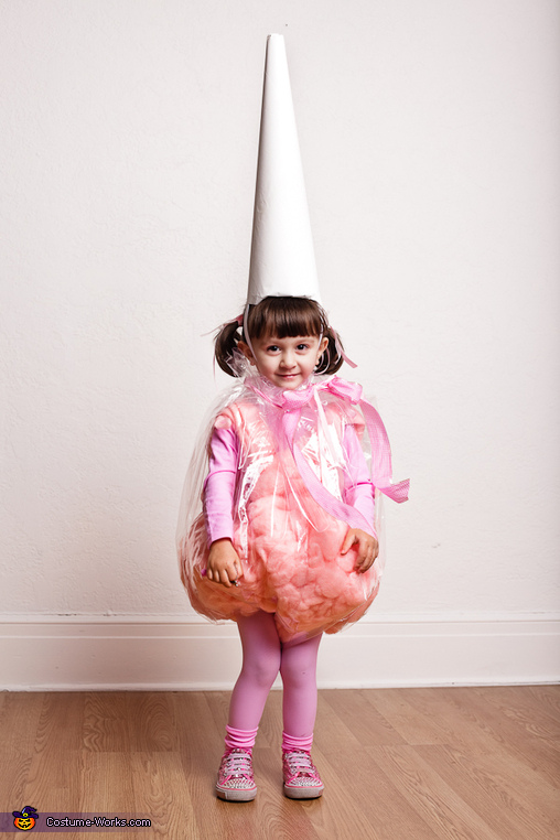 Girl in pink cotton candy Halloween costume