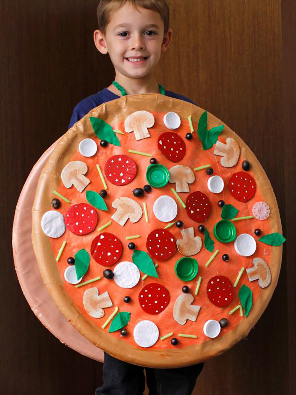 child with whole pizza costume on