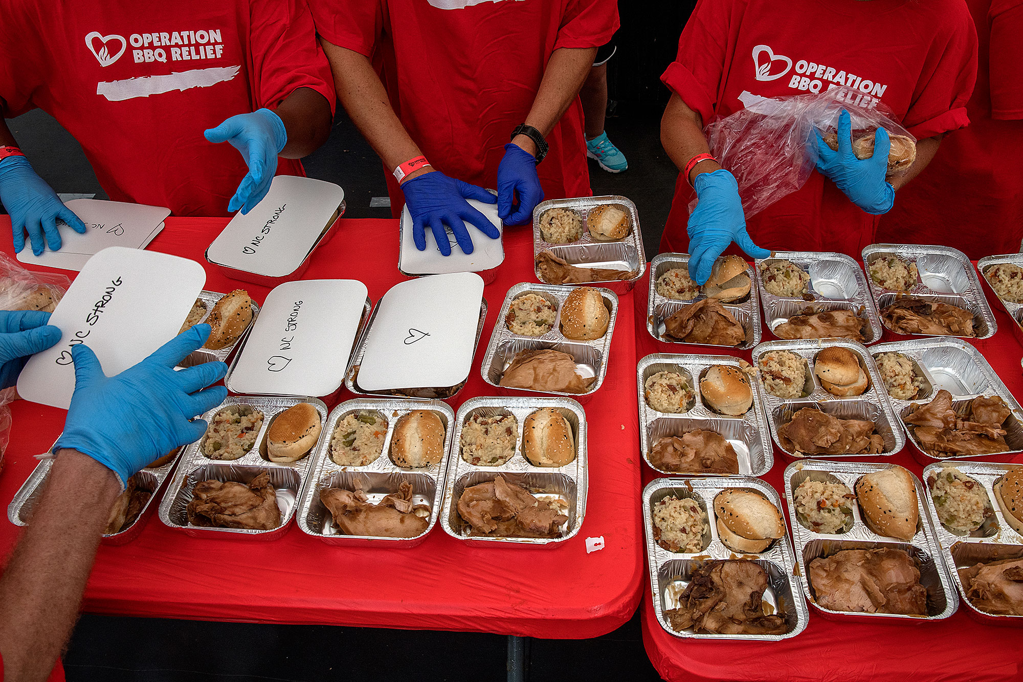 Volunteers pack up meals during Hurricane Florence efforts.