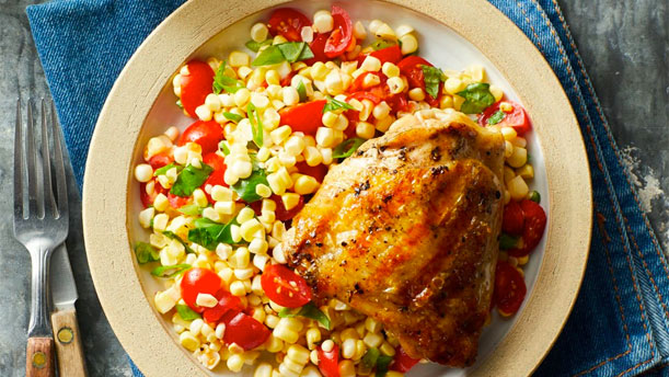 plate with grilled chicken and corn salad