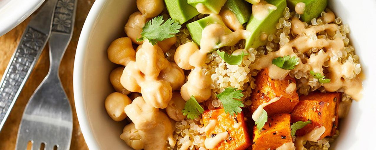 bowl with chickpeas avocado sweet potato and rice