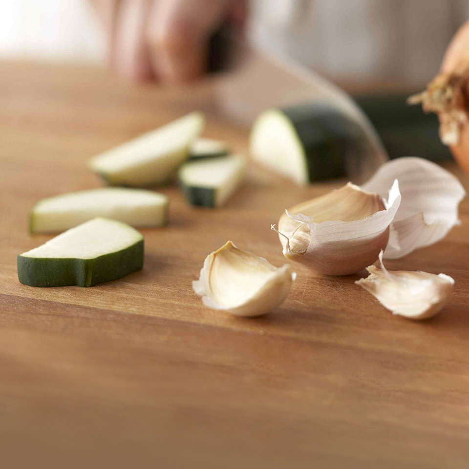garlic cloves and chopped zucchini