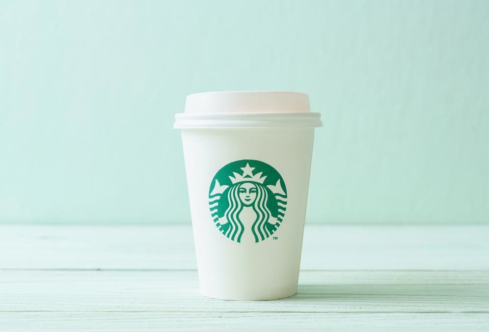 starbucks cup against teal background