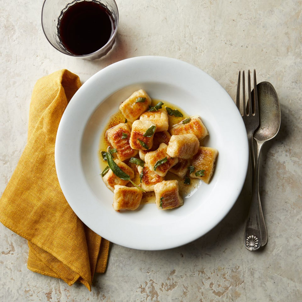 Cauliflower Gnocchi with Brown Butter & Sage Sauce served on white plate