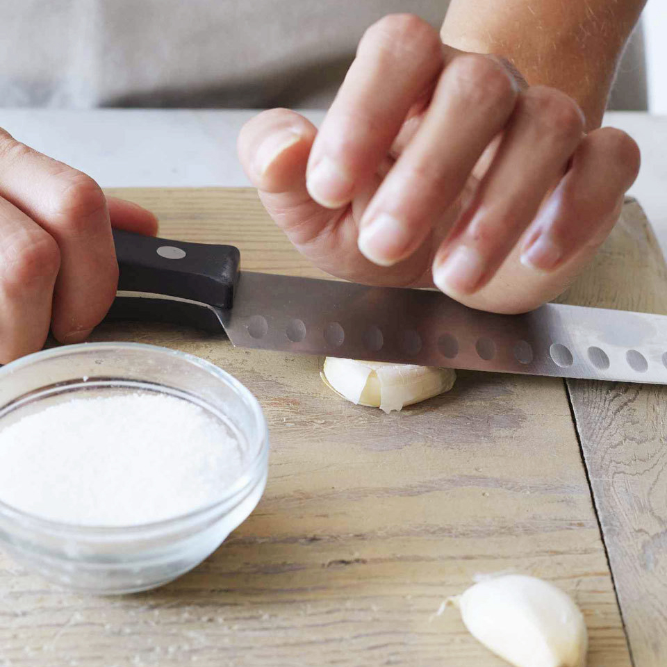 crushing garlic with knife blade