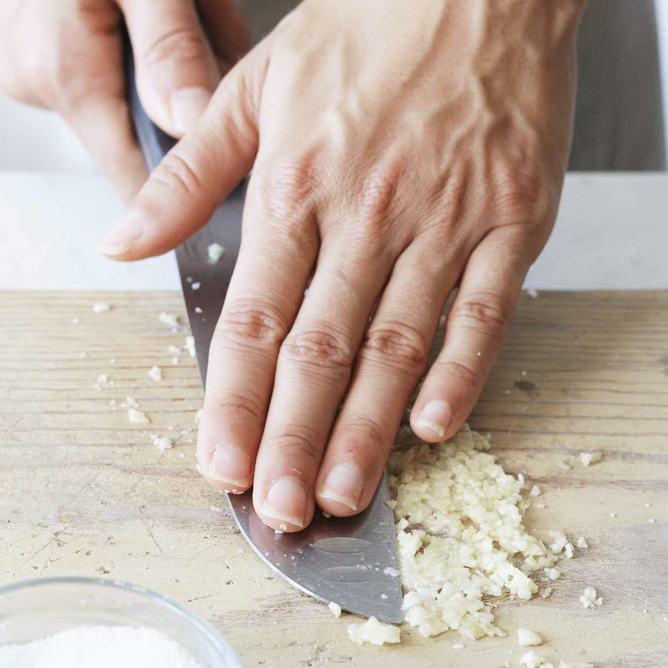 mashing garlic with knife