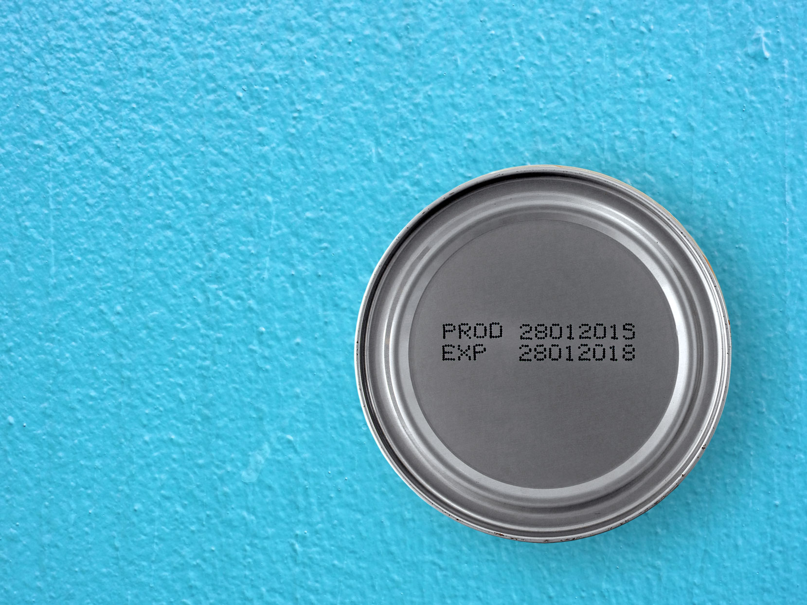 can of food with expiration date on blue background