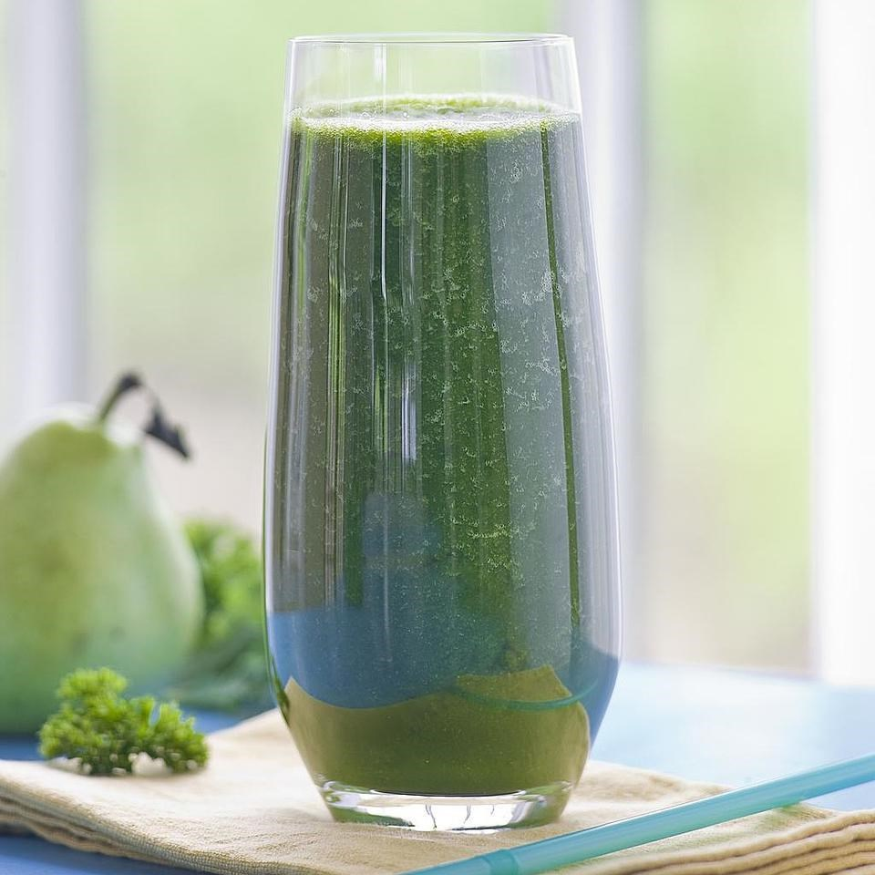 tall glass with green juice