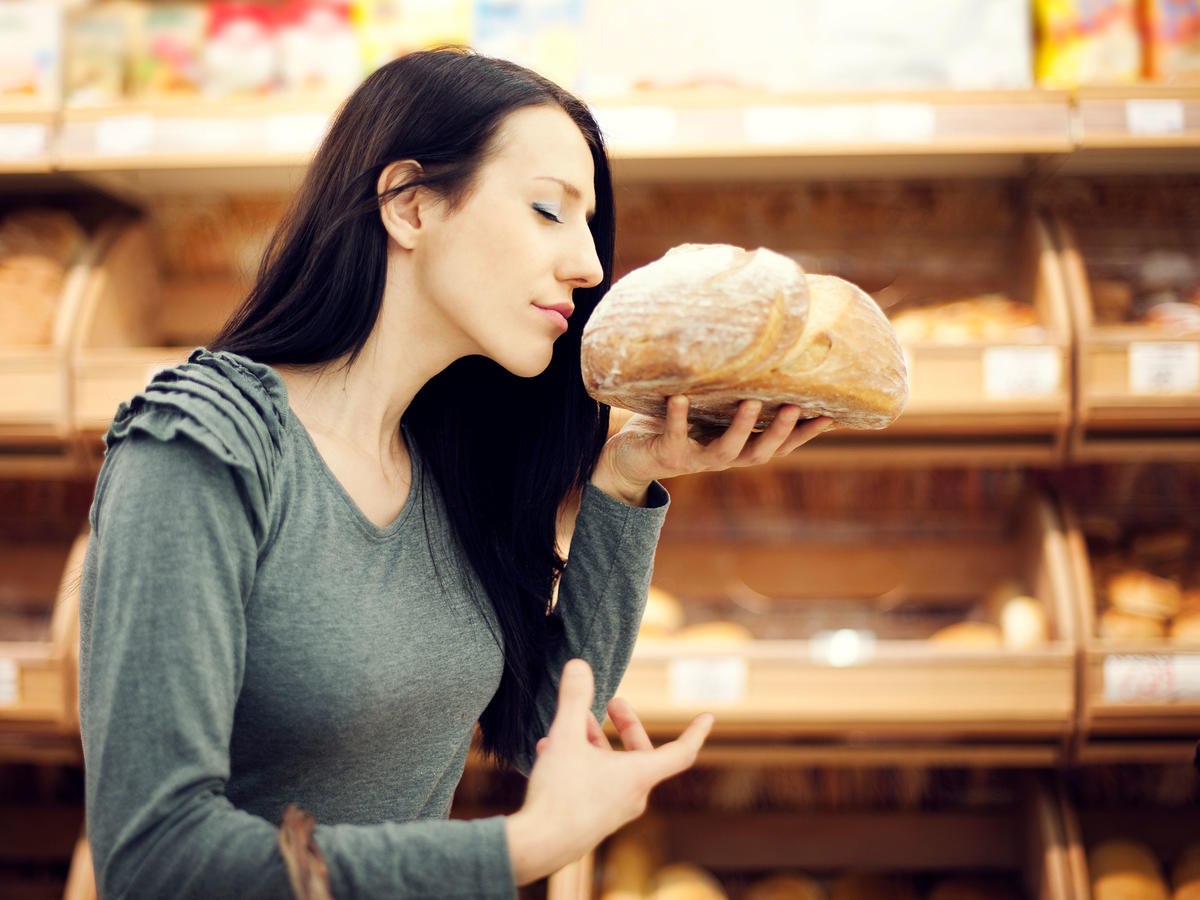 woman smelling bread