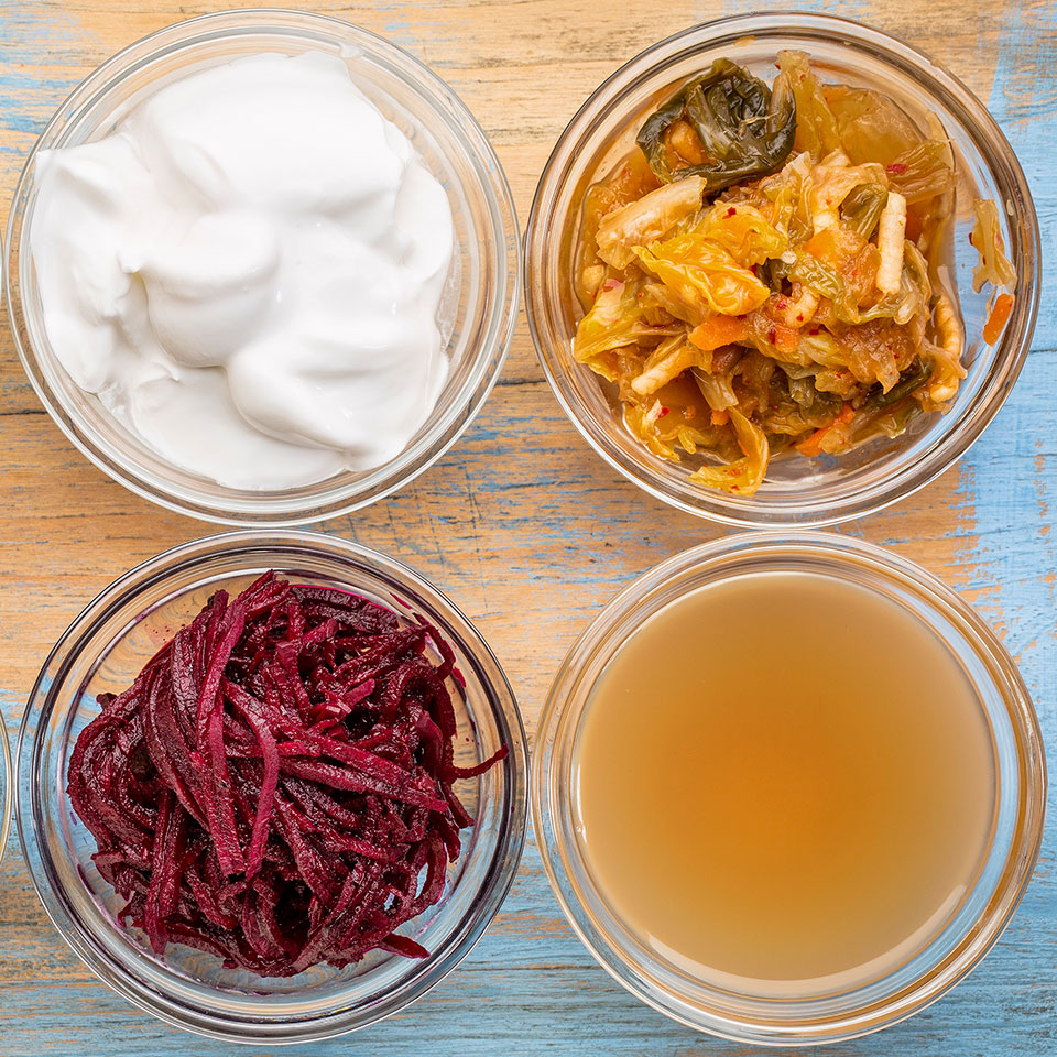 Bowls of fermented foods (yogurt, kimchi, beets, apple cider vinegar)