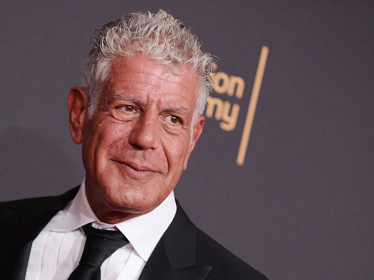 Anthony Bourdain wearing a suit