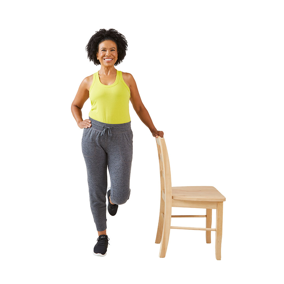woman raising hips to the right with hand on chair