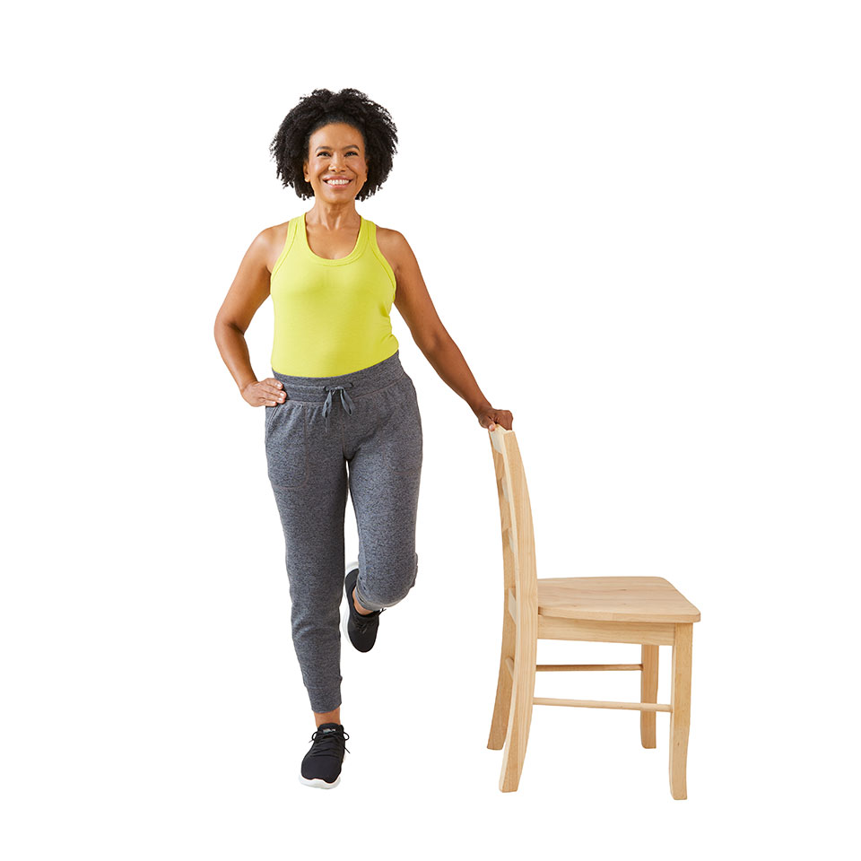 woman raising hips to the left with hand on chair