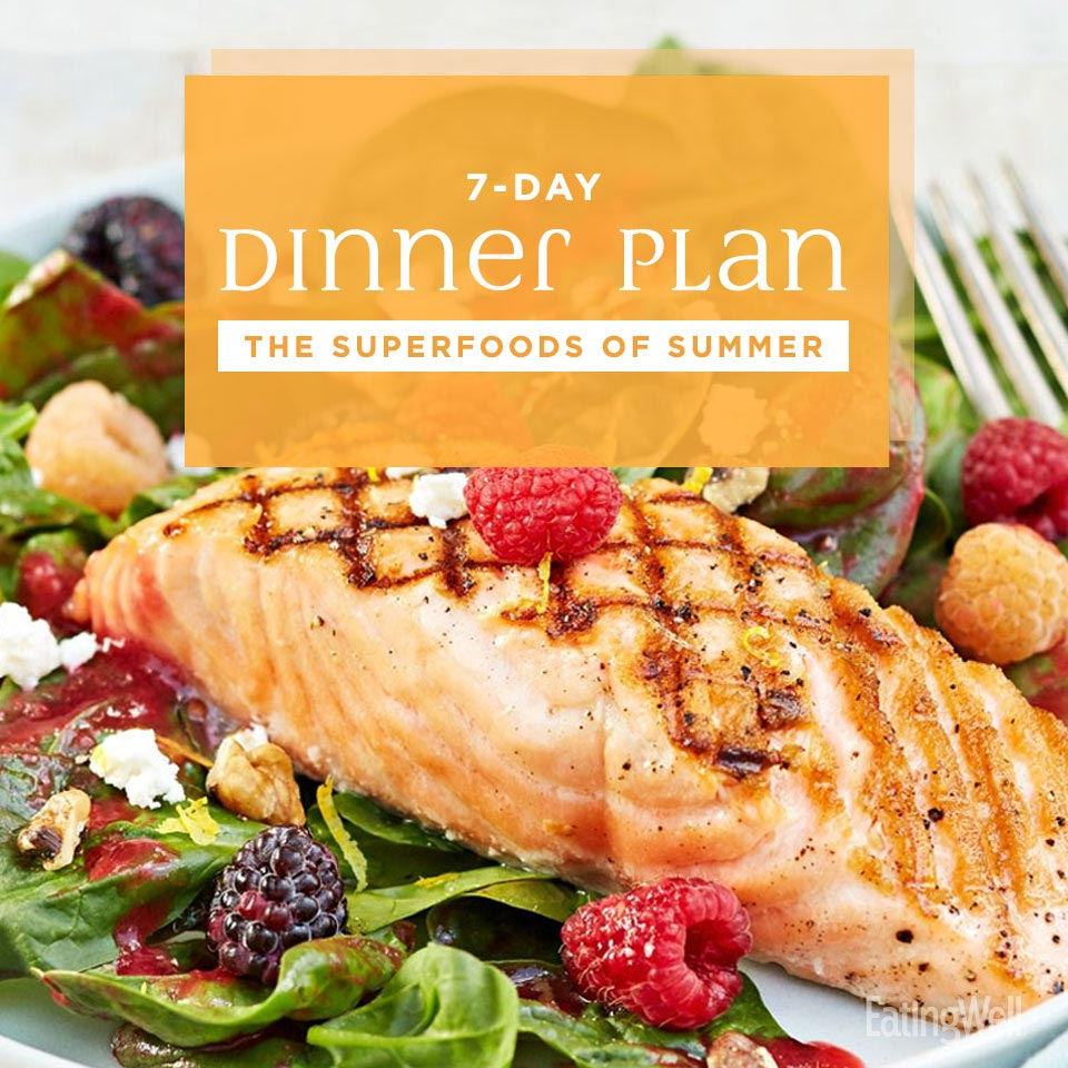 The Superfoods of Summer Dinner Plan, grilled salmon over a leafy green salad with fresh berries