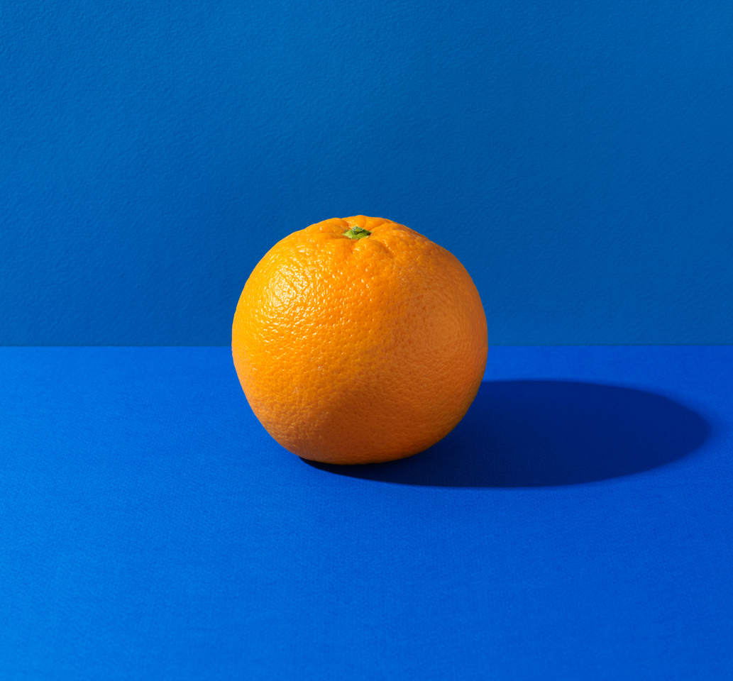 orange fruit against blue background