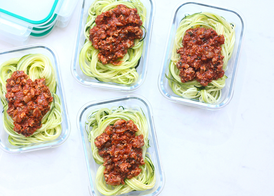 containers of zucchini noodles with bolognese sauce
