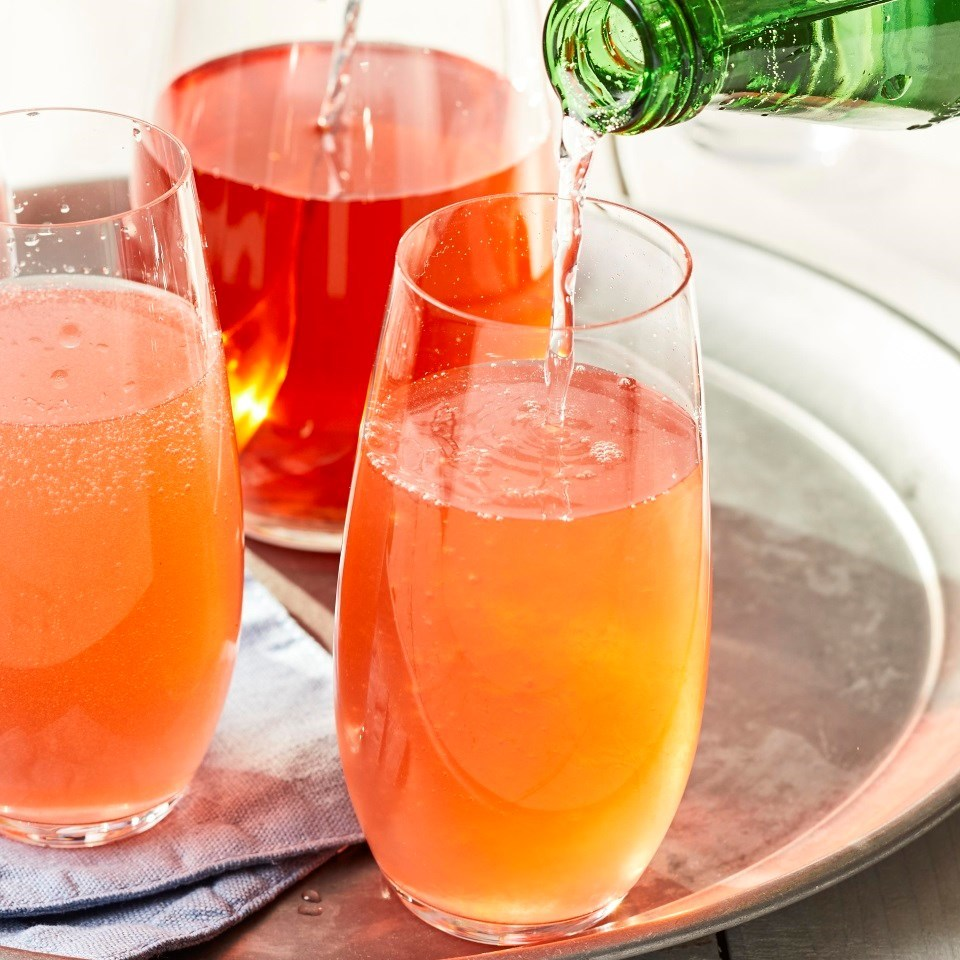 Strawberry Shrub Cocktail being poured in glasses