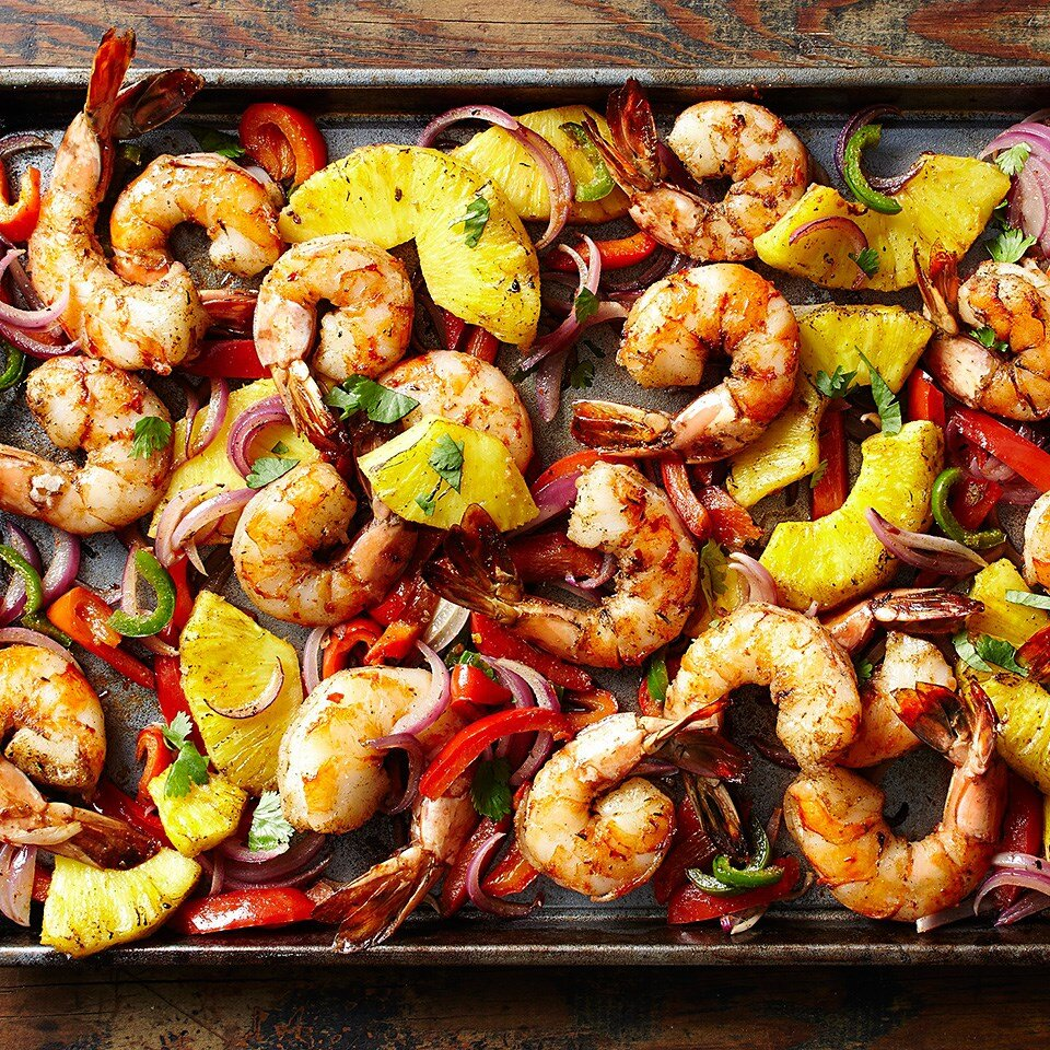 spicy jerk shrimp and pineapple on a sheet pan