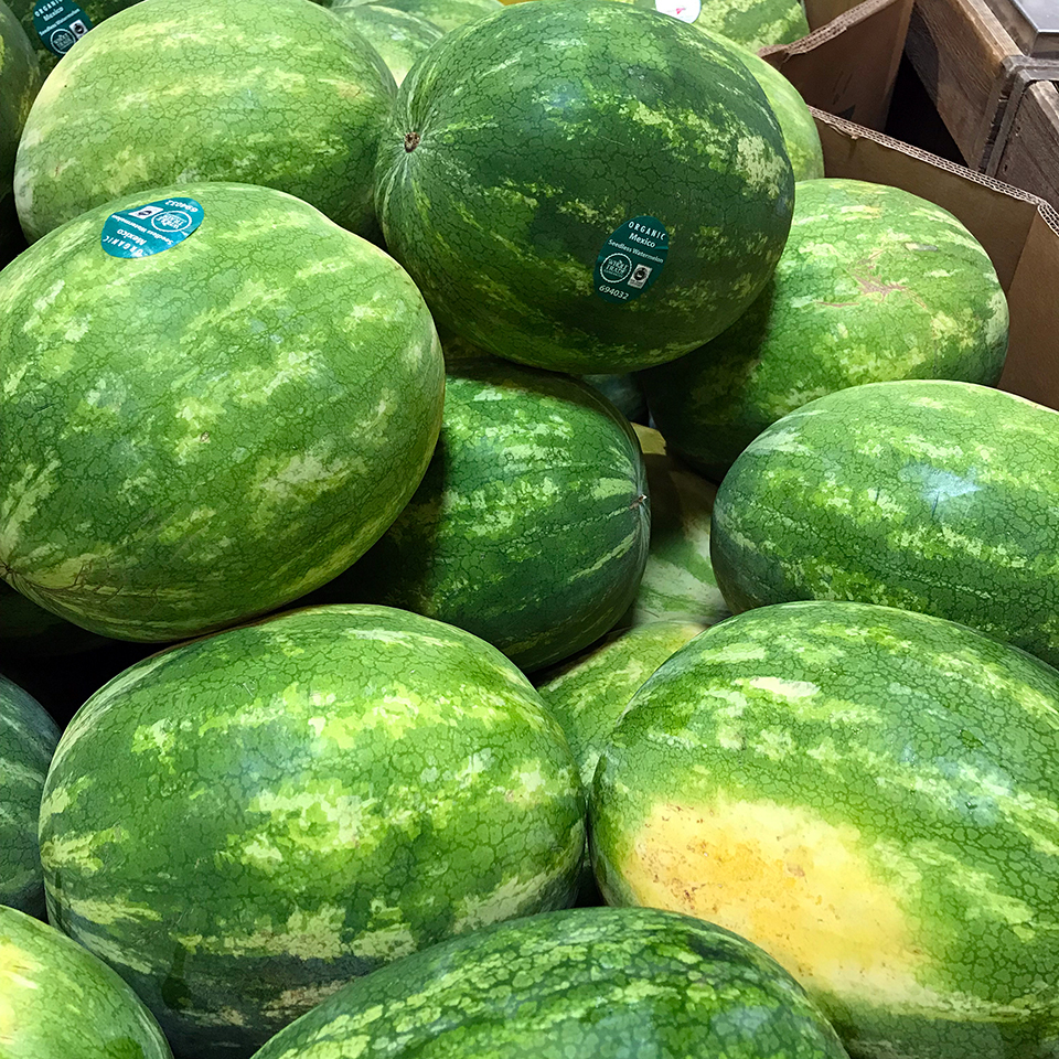 Selection of watermelons at grocery store.