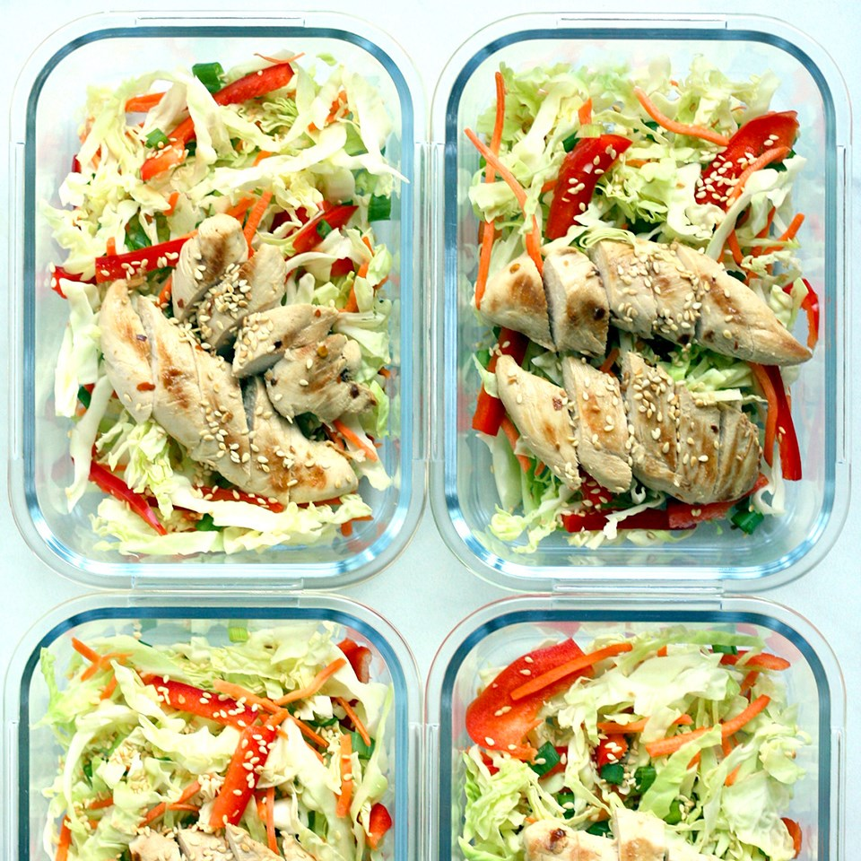 four containers of chicken lunches