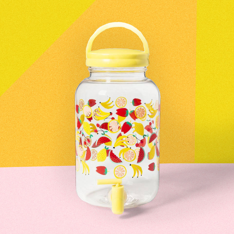 Fruit salad design on a drink dispenser with spigot