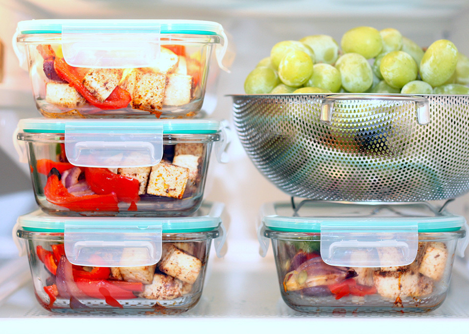 Fresh meals in containers stacked in the fridge
