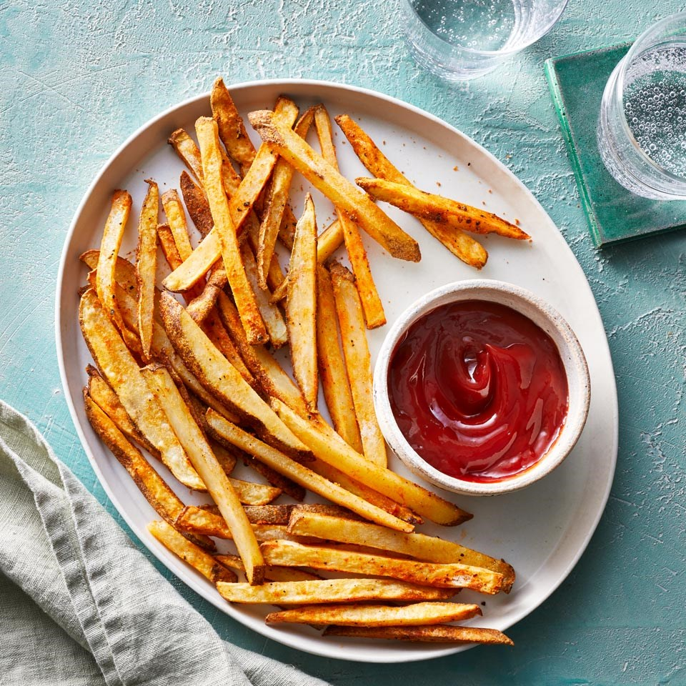 plate of french fries with a side of ketchup