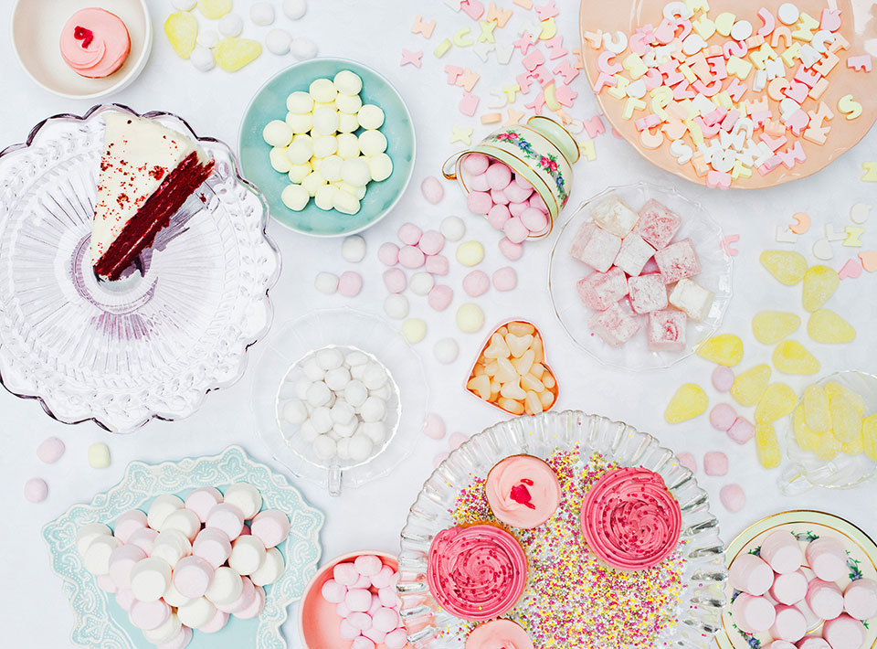 table of sugary candies and baked goods