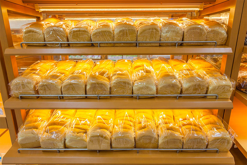 trays of loaves of sliced bread