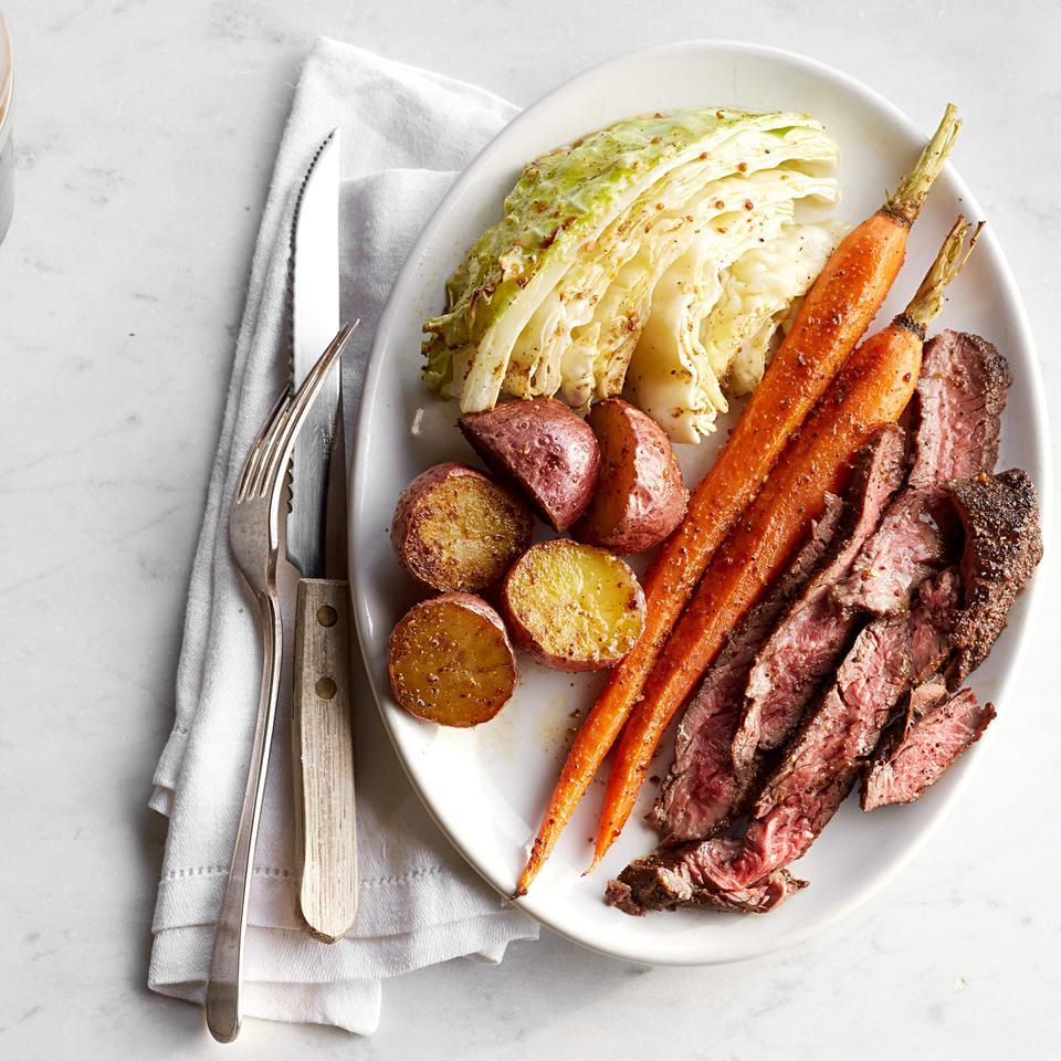 oval shaped plate with beef, carrots, potatoes and cabbage