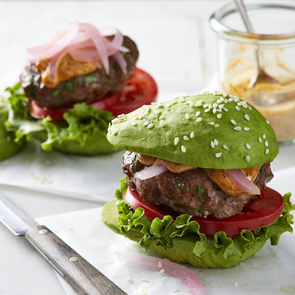 two sliders with avocados as the buns
