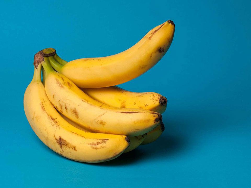 bundle of bananas on a blue background