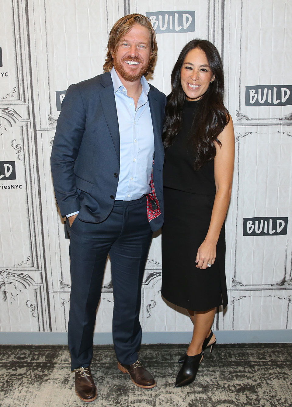 Chip and Joanna Gaines standing together and smiling