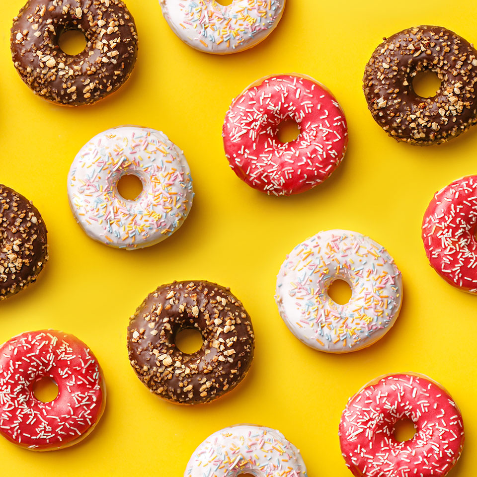 different colorful flavors of donuts