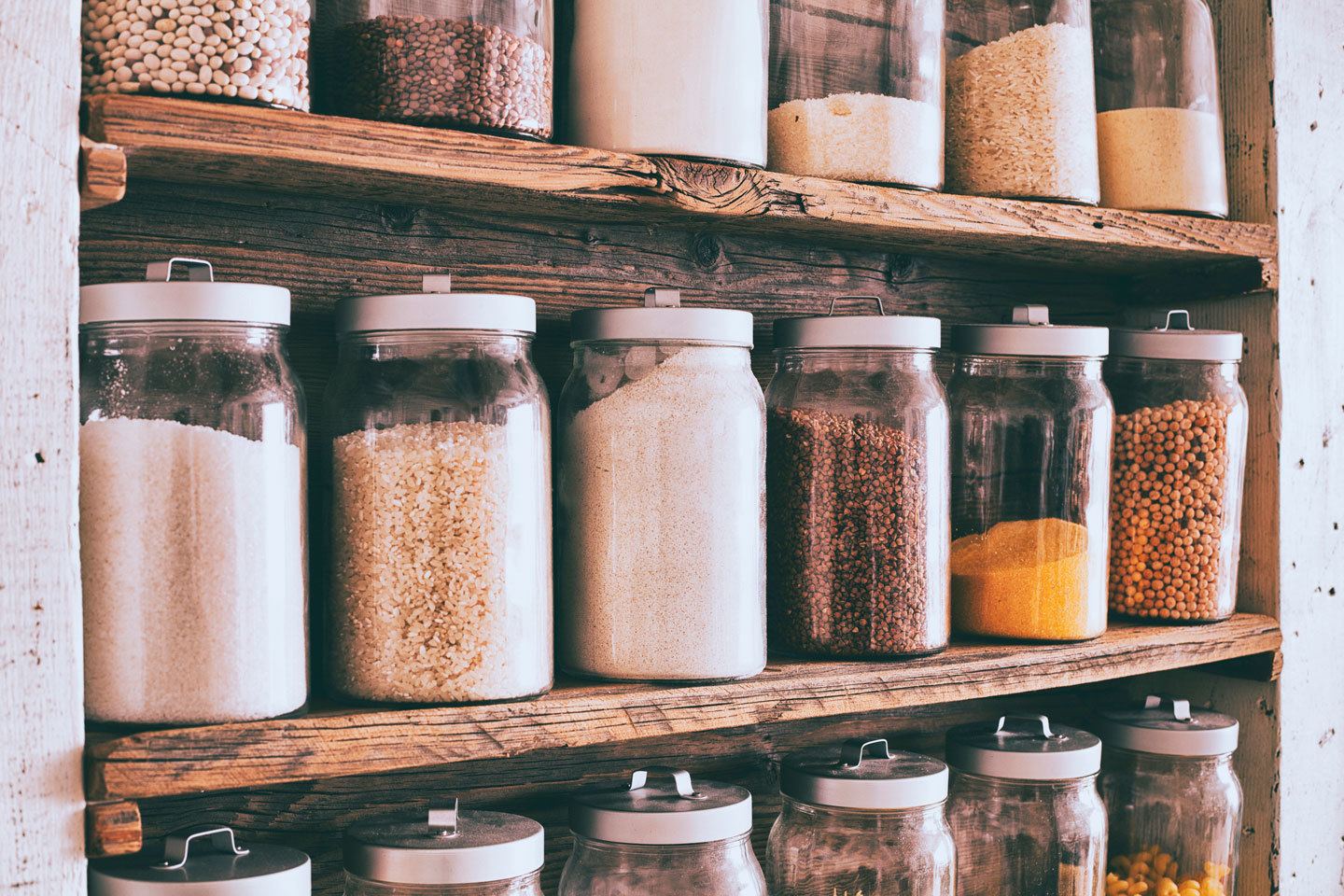 shelves with jars of dry ingredients and spices