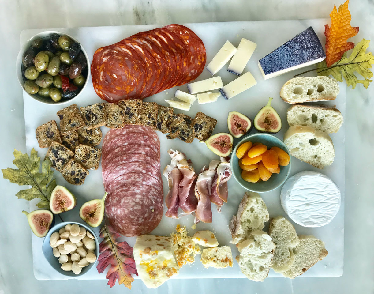 festive fall charcuterie board complete with cheese, meat, crackers and accoutrements