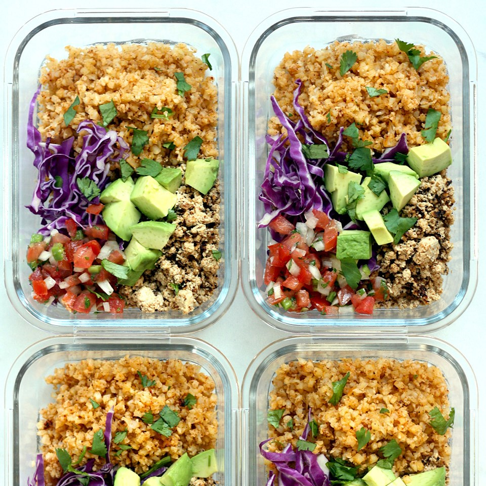 containers of vegan burrito bowls with cauliflower rice