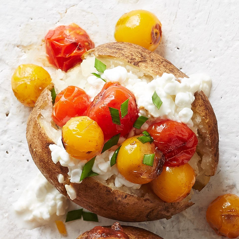 cottage cheese and roasted tomato topped baked potato
