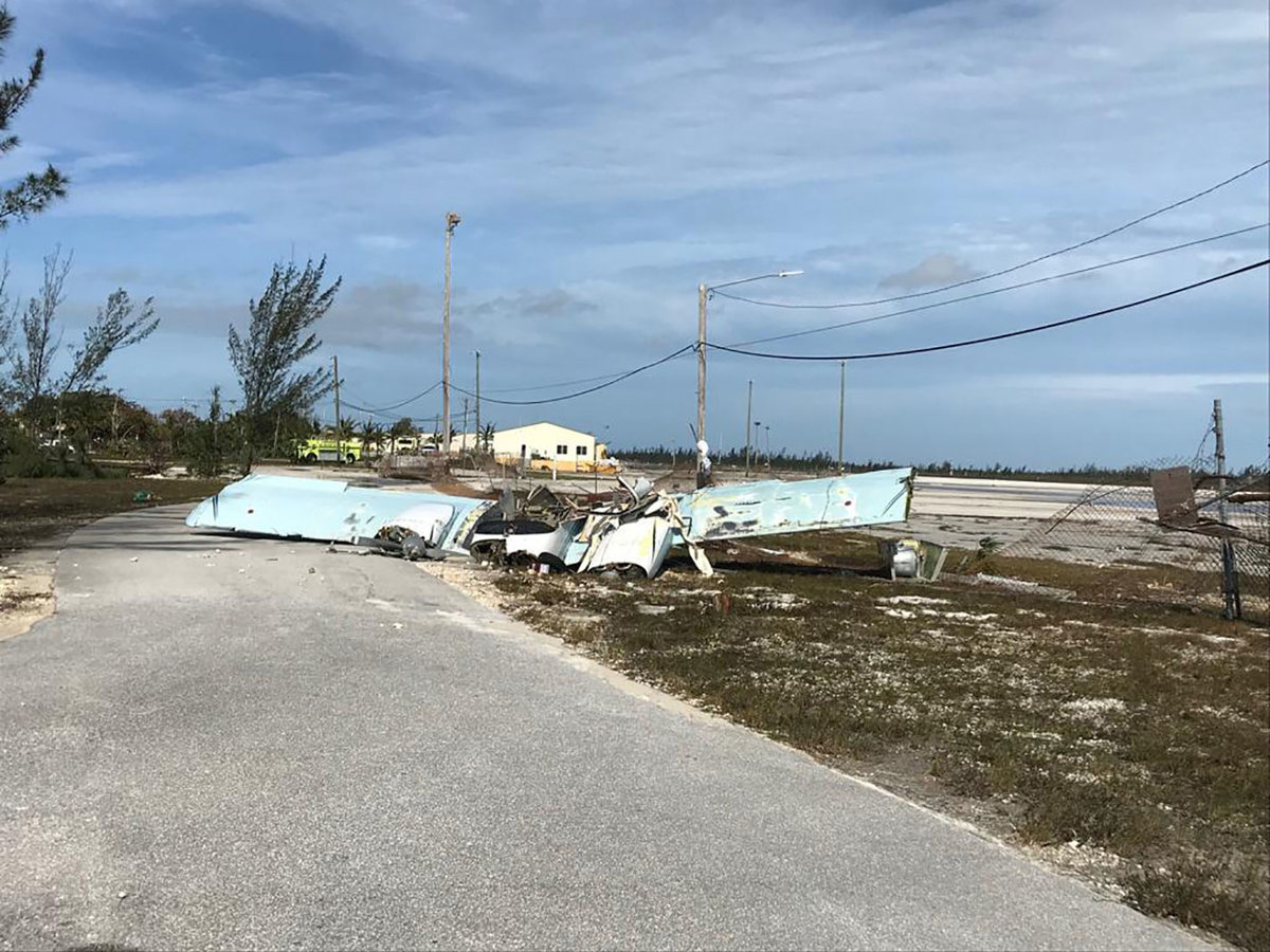 """Debris left by Hurricane Dorian litters Grand Bahama International Airport in Freeport, on September 4, 2019. - Dorian churned towards the US on Wednesday after leaving seven dead in the Bahamas, where the prime minister said terrified residents had endured """"days of horror"""" at the hands of the monster storm. Announcing the updated death toll, Prime Minister Hubert Minnis warned the number would rise as he called Dorian """"one of the greatest national crises in our country's history."""" (Photo by Yasmin RIGBY / AFP) / XGTY / RESTRICTED TO EDITORIAL USE - MANDATORY CREDIT """"AFP PHOTO / HO/ Yasmin Rigby""""- NO MARKETING NO ADVERTISING CAMPAIGNS - DISTRIBUTED AS A SERVICE TO CLIENTS == NO ARCHIVE (Photo credit should read YASMIN RIGBY/AFP/Getty Images)"""