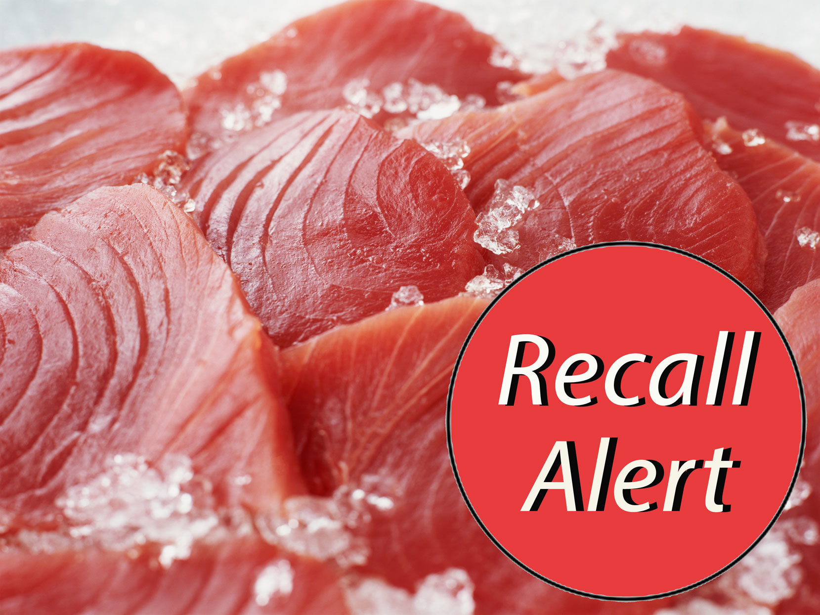 "raw tuna steaks on ice with a ""Recall Alert"" sticker"