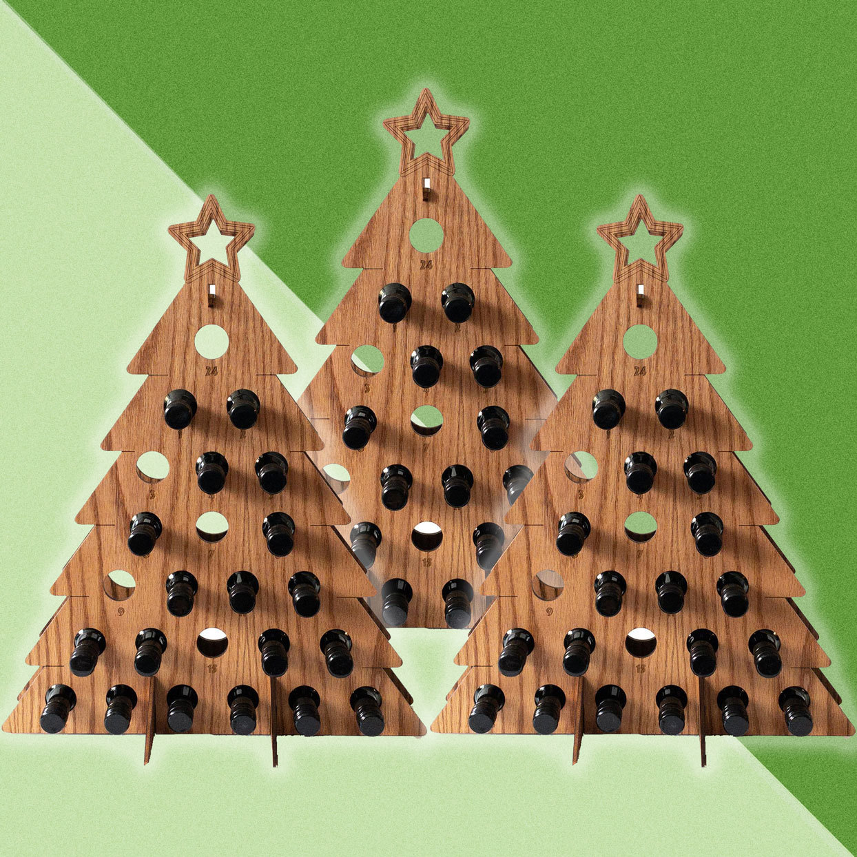3 wooden christmas tree shaped bottle holding wooden advent calendars