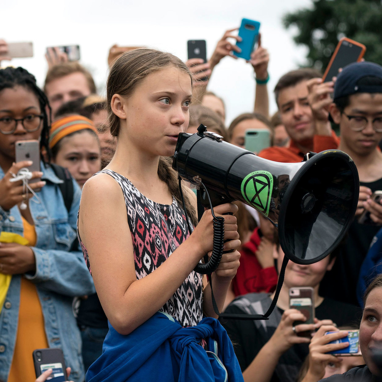 Greta Thunberg in a crowd with a megaphone