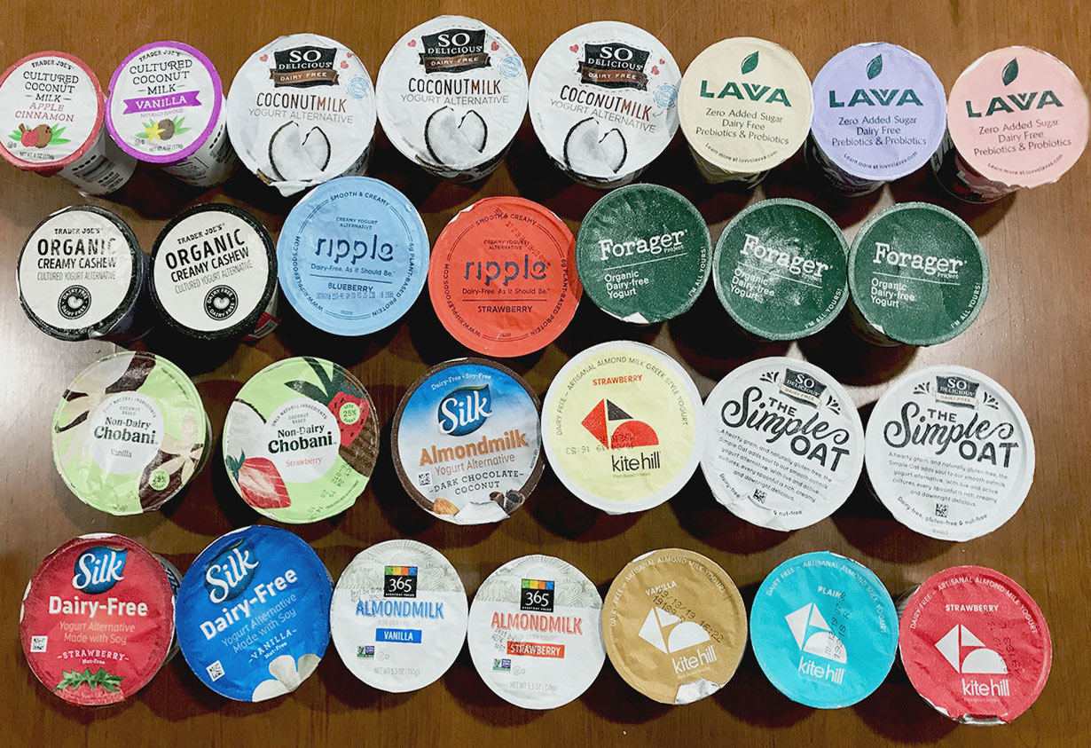 28 different types of vegan packaged flavored yogurt containers from above