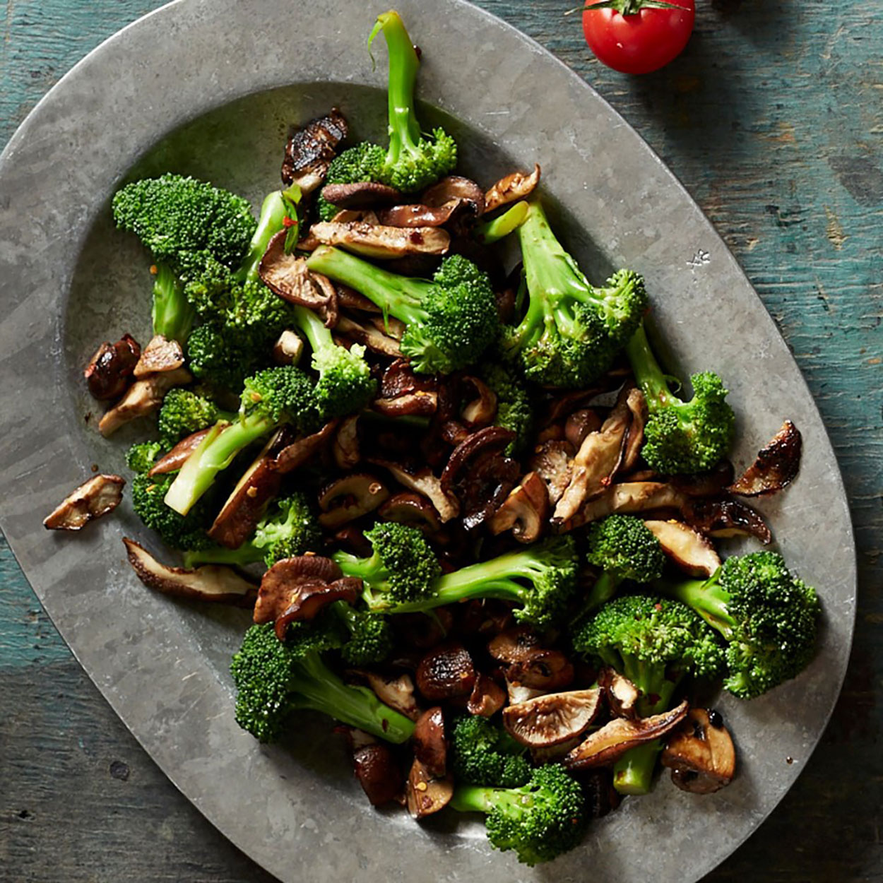 broccoli and mushrooms on a stone tray