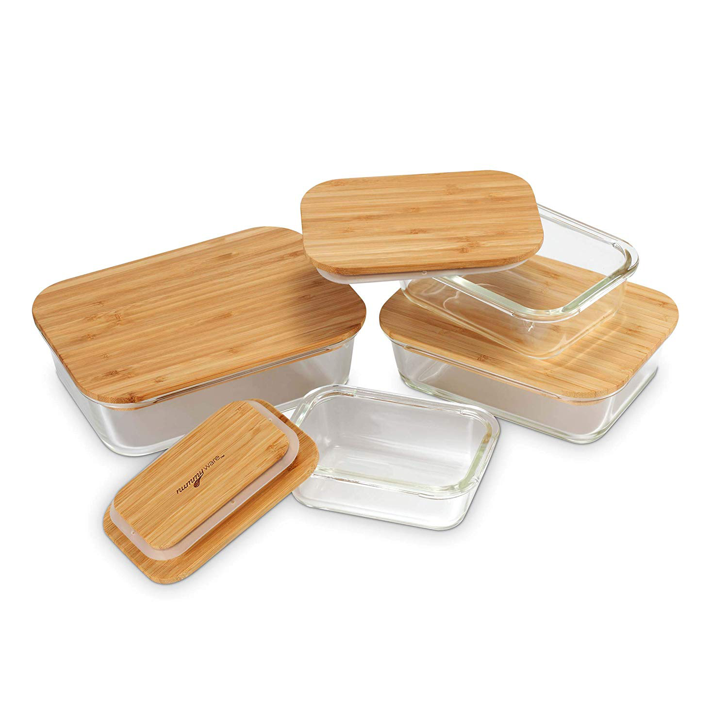 4 different sized glass containers with wooden lids