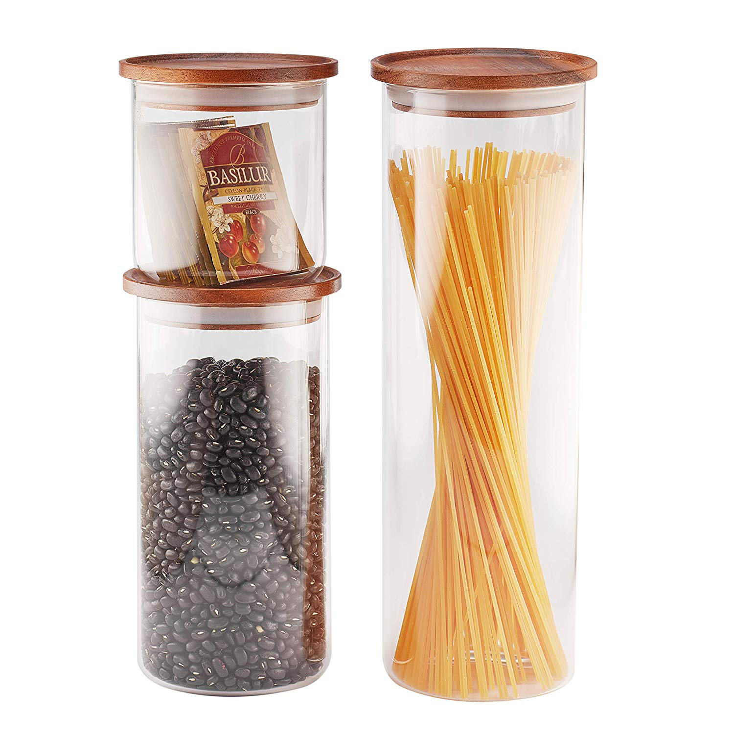 3 sizes of glass jars with wooden lids filled with pasta, beans, and tea bags