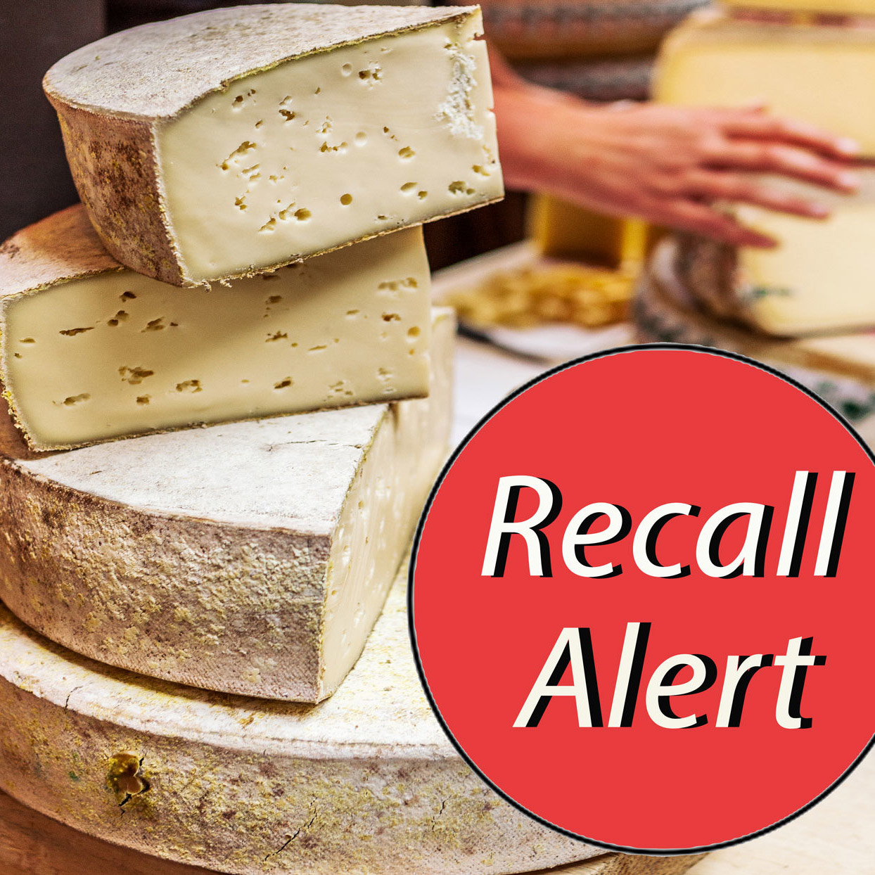 "wheels of cheese with ""Recall Alert"" sticker"