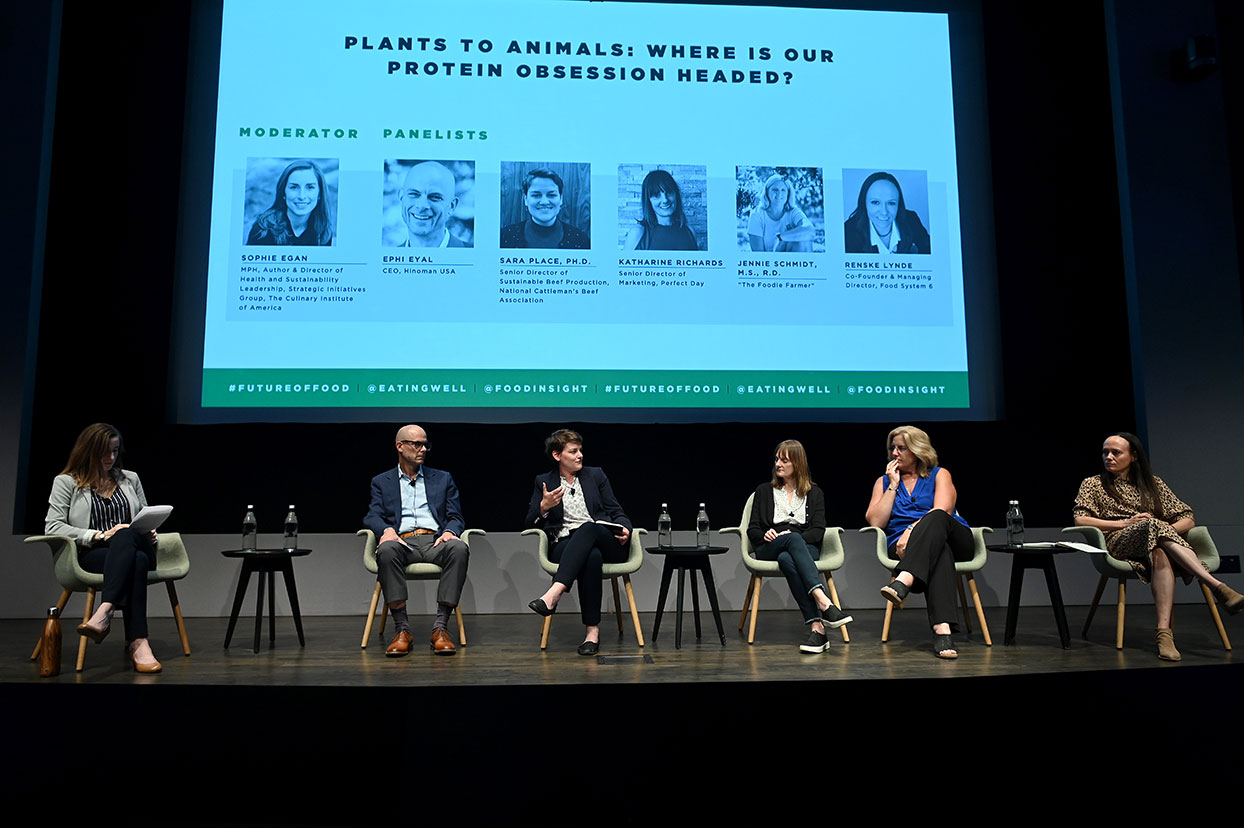 five expert panelists debate the future of protein, sitting on stage in front of screen